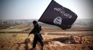 Jihadist carrying flag of Islamic State terrorist group