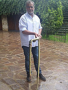 Roberto Calderoli with 6 foot snake found in his home