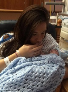 Jenna kisses the hand of newborn Shane
