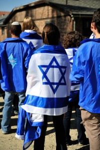 Student wearing an Israeli flag at the Auschwitz concentration camp
