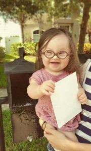 Emersyn helping mom send letter to her doctor