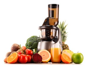 39662845 - slow juicer with organic fruits and vegetables isolated on white