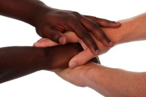 4052942 - hands of black and white males clasped together