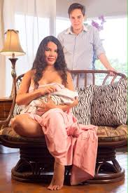 Diane Rodriquez (seated) and Fernando Machado with newborn son