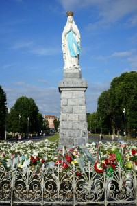 50648881 - lourdes, france - circa july 2015 statue madonna and flowers