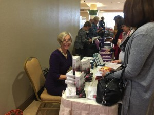 "Johnnette signing copies of her new book, ""Graceful Living,"" at the First Annual Women's Conference in the diocese of Allentown"