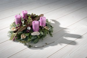 23875380 - advent wreath of twigs with purple candles and various ornaments