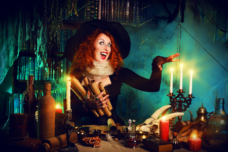 41845986 - attractive witch in the wizarding lair. fairytales. halloween.