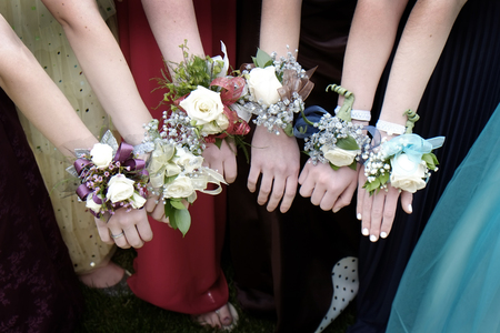 58422010 - girls with corsage flowers for prom dresses beautiful
