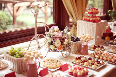 43272257 - table setting with flowers and sweets