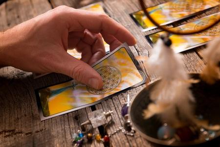51029175 - fortune teller holding a tarot card
