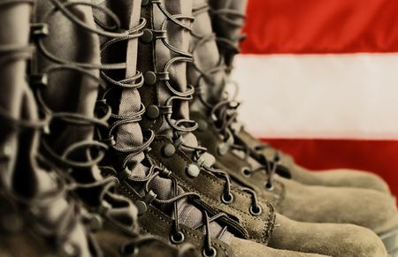 7711721 - sage green military combat boots with us flag in the background.