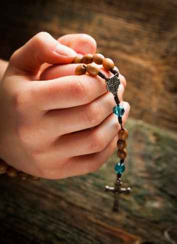 rosary in hand